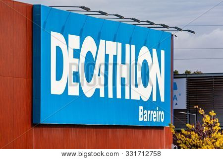 Coina, Portugal - October 23, 2019: Signboard of the Decathlon store in the Barreiro Planet Retail Park. Decathlon is a French company and the largest sporting goods retailer in the world