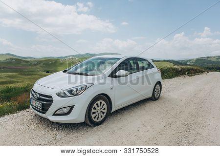 Montenegro, Zabljak, July 19, 2019 White Modern Hyundai I30 Car On A Rural Road During A Road Trip.