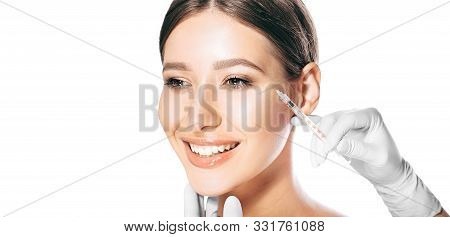 Female Face With Facial Wrinkles Near The Eyes With Beauty Injections. Botulinum Toxin Injections To