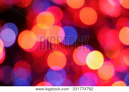 Christmas lights background. Defocused image of blue and red Christmas lights