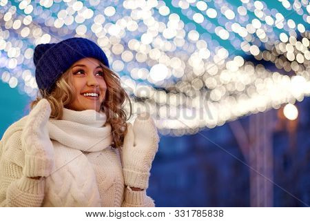 Smiling Woman With Garlands And Holiday Lights On Festive Christmas Or New Year Fair. Lady Wearing C