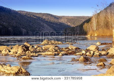 The River On Which The Shuga Floats In Front Of The Ice In The Foreground The Stones On The Other Si