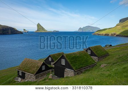 Bour Village. Typical Grass-roof Houses And Green Mountains. Vagar Island, Faroe Islands. Denmark. E