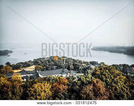 View From Leifeng Pagoda Hangzhou West Lake Autumn Scenery .mountain Range At Sunrise Sunset Orange