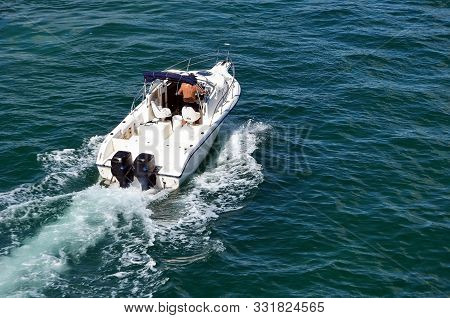 Young Couple Enjoying A Cruise On The Florida Intra-coastal Waterway In A Sport Fishing Boat Powered