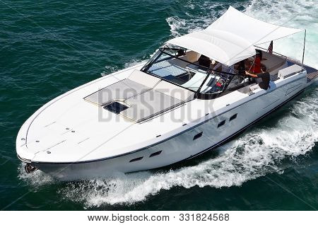 Angled Overhead View Of A White High-end Motor Boat Cruising The Florida Intra-coastal Waterway Off