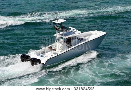 Twin Hulled Sport Fishing Boat Powered By Four Outboard Engines