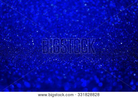 Abstract Blue Texture Glitter Lights Background. De-focused.