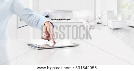 Smart Home Automation Control Concept Hand Touch Digital Tablet Screen On Kitchen Background Web Ban