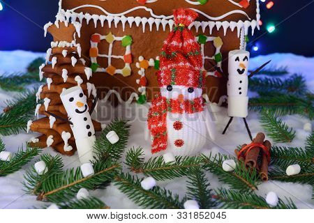 The Hand-made Eatable Gingerbread House, Snowman, Snow Decoration, Garland Snow And Background Illum