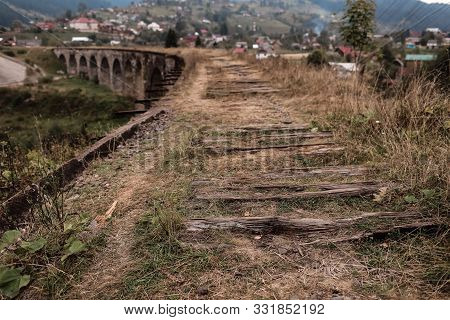 Close View Of Old Railroad Tracks With Worn Ties. Railway Viaduct Ukraine, Verkhovyna