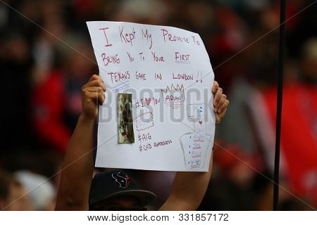 LONDON, ENGLAND - NOVEMBER 03 2019: A sign held aloft by a Texans fan during the NFL game between Houston Texans and Jacksonville Jaguars at Wembley Stadium