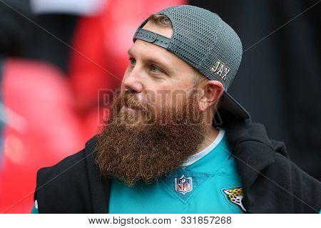 LONDON, ENGLAND - NOVEMBER 03 2019: A  bearded Jaguar fan during the NFL game between Houston Texans and Jacksonville Jaguars at Wembley Stadium