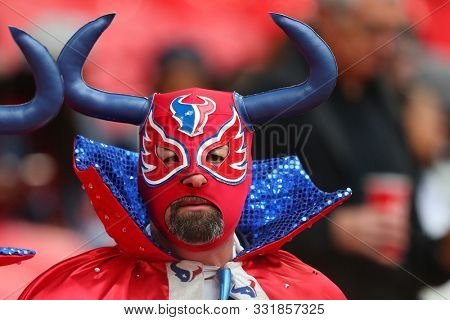 LONDON, ENGLAND - NOVEMBER 03 2019: A Texan fan during the NFL game between Houston Texans and Jacksonville Jaguars at Wembley Stadium