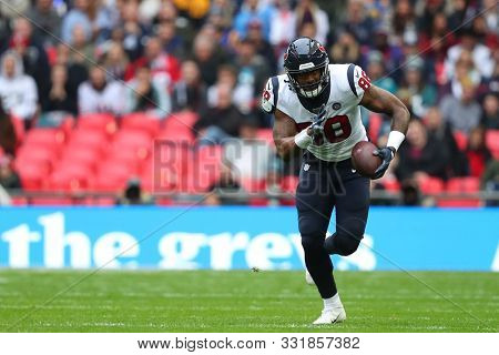 LONDON, ENGLAND - NOVEMBER 03 2019: Houston Texan's tight end, Jordan Akins (88) runs with the ball during the NFL game between Houston Texans and Jacksonville Jaguars at Wembley Stadium