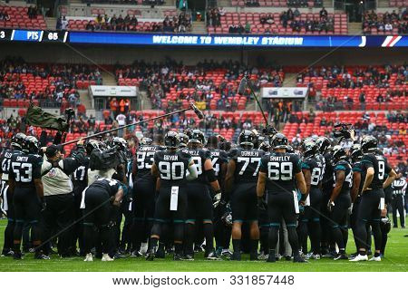 LONDON, ENGLAND - NOVEMBER 03 2019: Jaguars team huddle during the NFL game between Houston Texans and Jacksonville Jaguars at Wembley Stadium