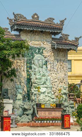 Da Nang, Vietnam - March 10, 2019: Chua An Long Chinese Buddhist Temple. Greenish Stone Guan Yin Sta