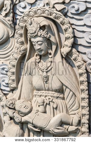 Da Nang, Vietnam - March 10, 2019: Chua An Long Chinese Buddhist Temple. Closeup Of Gray Stone Happy