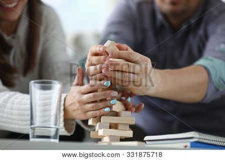 Focus On Wooden Tabletop Board Game. Worried People Spending Quality Time With Close Friend Or Relat