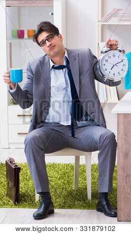 The businessman late for office due to oversleeping after overni