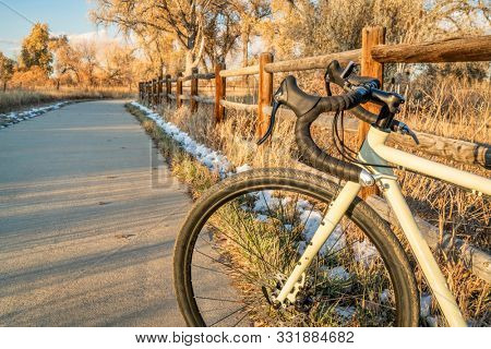 touring bicycle on a bike trail in late fall scenery - Poudre River Trail in northern Colorado