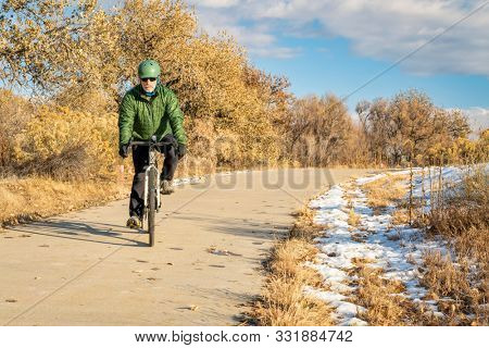 Winter commuting on a bike trail - Poudre River Trail in northern Colorado