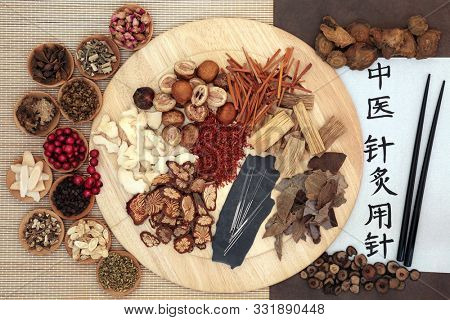 Chinese herbs and acupuncture needles with calligraphy script used in herbal medicine. Translation reads as acupuncture needles used in traditional chinese medicine.