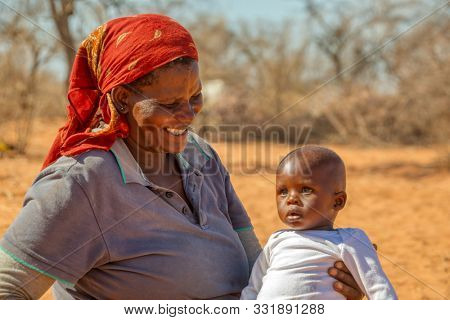 portrait of an african child with her mom in a village near Kalahari desert,
