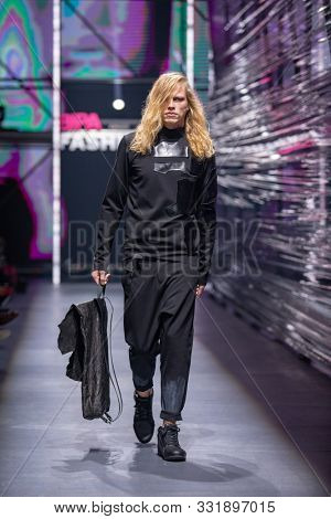 ZAGREB, CROATIA - OCTOBER 26, 2019: Fashion model wears clothes designed by the Spirit by T.B. at the 'Fashion.hr' fashion show