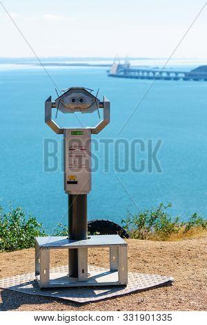 Kerch, Crimea, Russia - October 9, 2019: Tourist Binoculars To View Crimean Bridge Across Kerch Stra