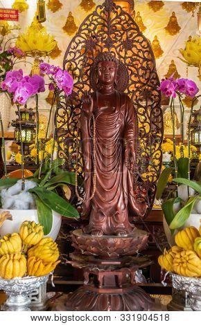 Da Nang, Vietnam - March 10, 2019: Chua An Long Chinese Buddhist Temple. Brown-maroon Wooden Guan Yi
