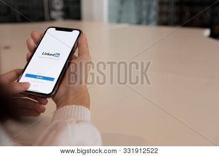 Chiang Mai, Thailand, Oct 27, 2019 : A Women Holds Apple Iphone Xs With Linkedin Application On The