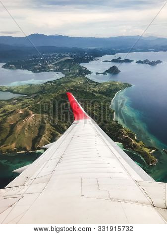 Tropical Island Coastline View From The Plane. Travel And Vacations Concept. Flores, Labuan Bajo. In