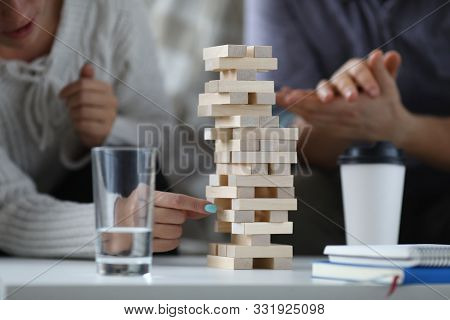 Focus On Wooden Tabletop Game For Several Players. Happy People Spending Quality Time With Close Fri