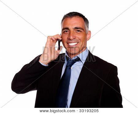 Senior Executive Man Smiling On Mobile