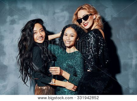 Pretty Multiethnic Young Women Have Fun Together. Friendship, Party, Celebration Concept