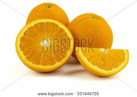 Fresh Navel Oranges Isolated On White Background. Save With Clipping Path.