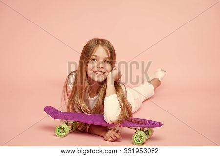 Kid Adorable Child Long Hair Adore Ride Penny Board. Happy Childhood. Ride Penny Board And Do Tricks