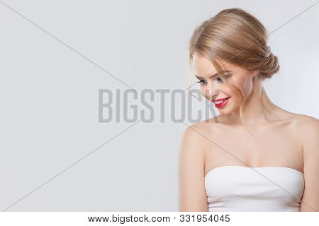 Pretty Model With Blonde Updo Hairdo And Red Lips