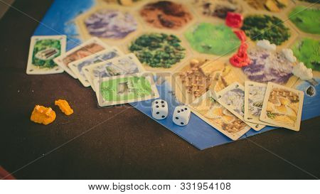 Russia/saint-petersburg -30.10.2019: Board Game Party With My Friends. Playing Cards. Settlers Of Ca