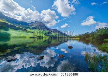 Mountains reflected on a lake at the Lake District in England