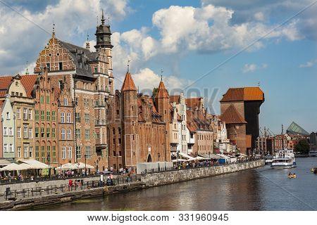 Gdansk, Pomeranian / Poland - August 20 2019: Old Historic Buildings At Long Riverside In Gdansk Old