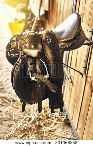 Leather Horse Saddle In A Stable Hanging On The Wall