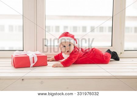 Beautiful Little Baby Celebrates Christmas. New Years Holidays. Baby In A Christmas Costume And In S