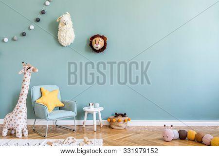 Stylish Scandinavian Kid Room With Toys, Teddy Bear, Plush Animal Toys, Mint Armchair, Cotton Balls.