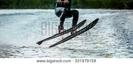 Male Water Skiing Athlete Water Skier Jump On Lake