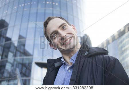 Crazy Funny Guy, Businessman Grimaces, Smiling Outdoors Near Business Centre. Tight Smile. Mad, Deme
