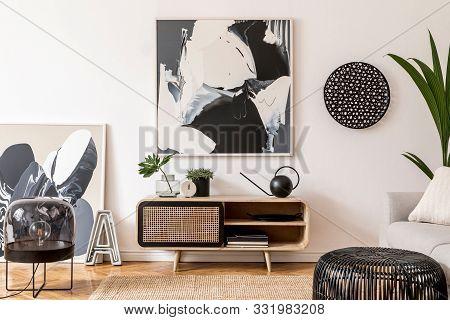 Stylish Scandinavian Living Room Interior With Gray Sofa, Black Lamp, Design Commode, Tropical Plant