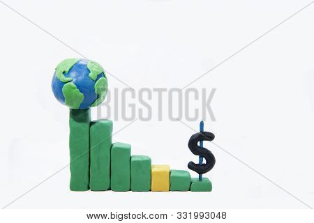 Businesswoman Conceptual Photo.  Graph Made From Play Clay With Dollar Sign.