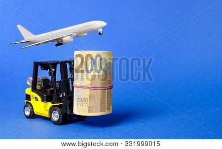 Forklift Truck Carries A Bundle Of Euro And Airplane. Attracting Direct Investment In Business And P